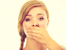 Sad woman covering mouth with hand Royalty Free Stock Photos