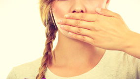 Sad woman covering mouth with hand Stock Image