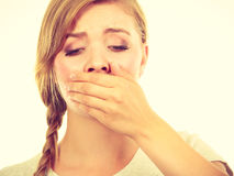 Sad woman covering mouth with hand Royalty Free Stock Image