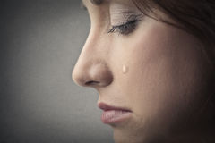 Sad woman crying Stock Images