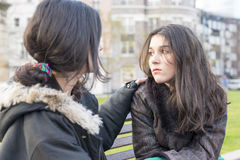 Sad woman crying and friend conforting in the park. Royalty Free Stock Photos