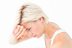 Sad woman crying with hand on forehead Royalty Free Stock Image
