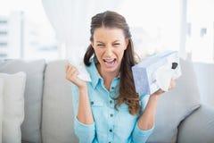 Sad woman crying sitting on sofa Royalty Free Stock Image