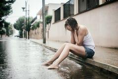 Sad woman crying. Sad woman crying on the street Stock Photo