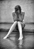Sad woman crying on the street. Black and white photo Stock Photography