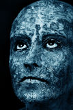 Damaged skin mask. Sad woman with damaged skin mask looking up in dark Royalty Free Stock Photo