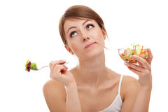 Sad woman on diet with vegetables. Isolated on white background Stock Photo