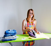 Sad woman of doing the ironing. Stock Images