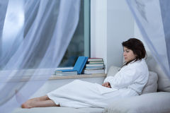 Sad woman in dressing gown Stock Photography