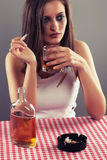 Sad woman drinking alcohol Royalty Free Stock Images