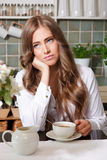 Sad woman drinking coffee Royalty Free Stock Photos