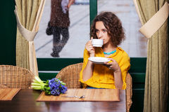Sad fashion woman drinking tea at restaurant Royalty Free Stock Image