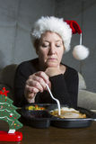 Sad Woman Eating Christmas Dinner Alone Stock Image