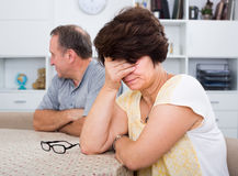Sad woman experiencing family problems Royalty Free Stock Photo