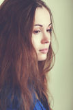 Sad woman face. Close up she is depressed and looking down Royalty Free Stock Photos