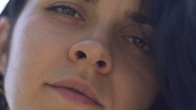 Sad woman face close-up, mix raced female dark hair blinks, slow motion portrait. Stock footage stock footage