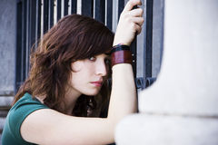 Sad woman in fence Stock Images