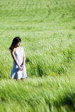 Sad woman on field. Sad young woman on green meadow stock photos