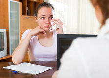Sad woman filling questionnaire Stock Images