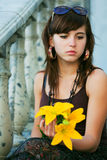 Sad young fashion woman with a flowers Royalty Free Stock Photography