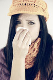 Sad woman with flu sneezing isolated Royalty Free Stock Photography