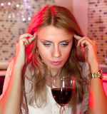 Sad woman with glass of red wine royalty free stock photos