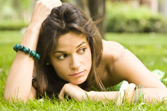 Sad woman on grass Stock Photography