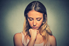 Sad woman on gray wall background stock photo