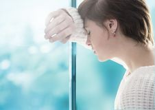 Sad woman grief leaning against a window. Digital composite of Sad woman grief leaning against a window stock photos
