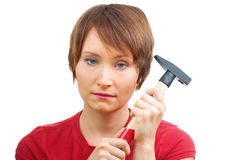 Sad woman with  hammer Royalty Free Stock Photos