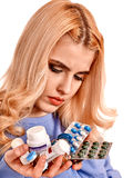 Sad woman having flu takes pills. Stock Image