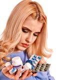 Sad woman having flu takes pills. Isolated Stock Image