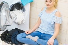 Unhappy woman having a lot of laundry royalty free stock image