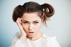The sad woman with a headache Royalty Free Stock Photos