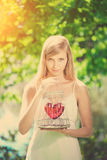 Sad woman with a heart in a cage Stock Photo