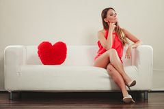 Sad woman with heart shape pillow. Valentines day. Royalty Free Stock Photos
