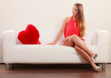 Sad woman with heart shape pillow. Valentines day. Stock Photo