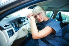 Sad woman in her car Stock Photo