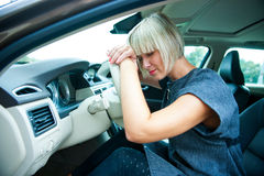 Sad woman in her car Stock Photography