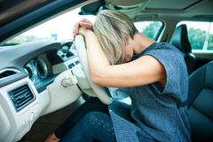 Sad woman in her car Stock Photos