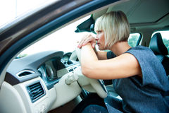 Sad woman in her car Royalty Free Stock Photo