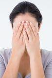 Sad woman hiding her face Stock Photography
