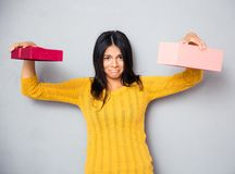 Sad woman holding empty gift box Royalty Free Stock Images
