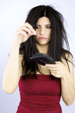 Sad woman holding fallen hair healthcare problems Royalty Free Stock Photography