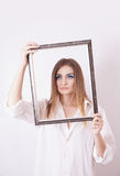 Sad woman holding a frame in his hands Stock Photo