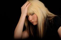 Sad woman holding head Stock Photo