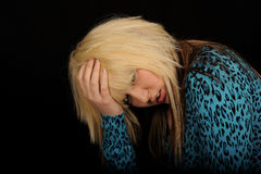 Sad woman holding head Royalty Free Stock Photo