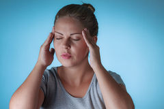 Sad woman holding her head with headache Stock Images