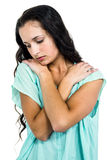 A Sad woman holding herself. Sad woman on white background royalty free stock images