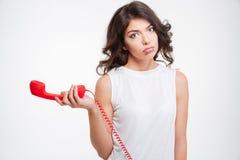 Sad woman holding phone tube Royalty Free Stock Image